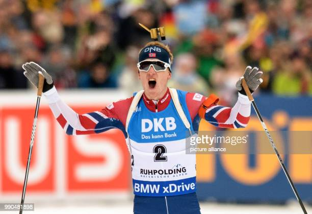 Johannes Thingnes Boe of Norway celebrates at the finish line during the men's mass start event of the Biathlon World Cup at the Chiemgau Arena in...