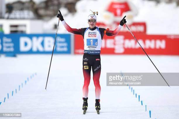 Johannes Thingnes Boe of Norway celebrates at the finish line winning the Mixed Relay at the IBU World Championships Biathlon AntholzAnterselva on...
