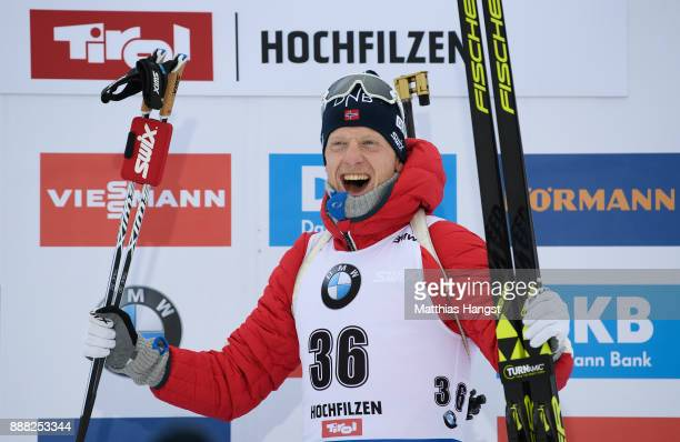 Johannes Thingnes Boe of Norway celebrates on the podium after winning the 10 km Men's Sprint during the BMW IBU World Cup Biathlon on December 8...
