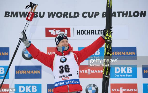 Johannes Thingnes Boe of Norway celebrates on the podium after winning the 10 km Men's Sprint during the BMW IBU World Cup Biathlon on December 8,...