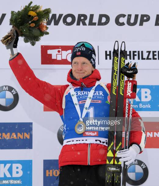 Johannes Thingnes Boe of Norway celebrates on the podium after the 125 km Men's Pursuit during the BMW IBU World Cup Biathlon on December 9 2017 in...