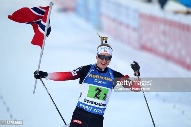 Johannes Thingnes Boe of Norway celebrates victory in the IBU Biathlon World Championships Single Mixed Relay at Swedish National Biathlon Arena on...