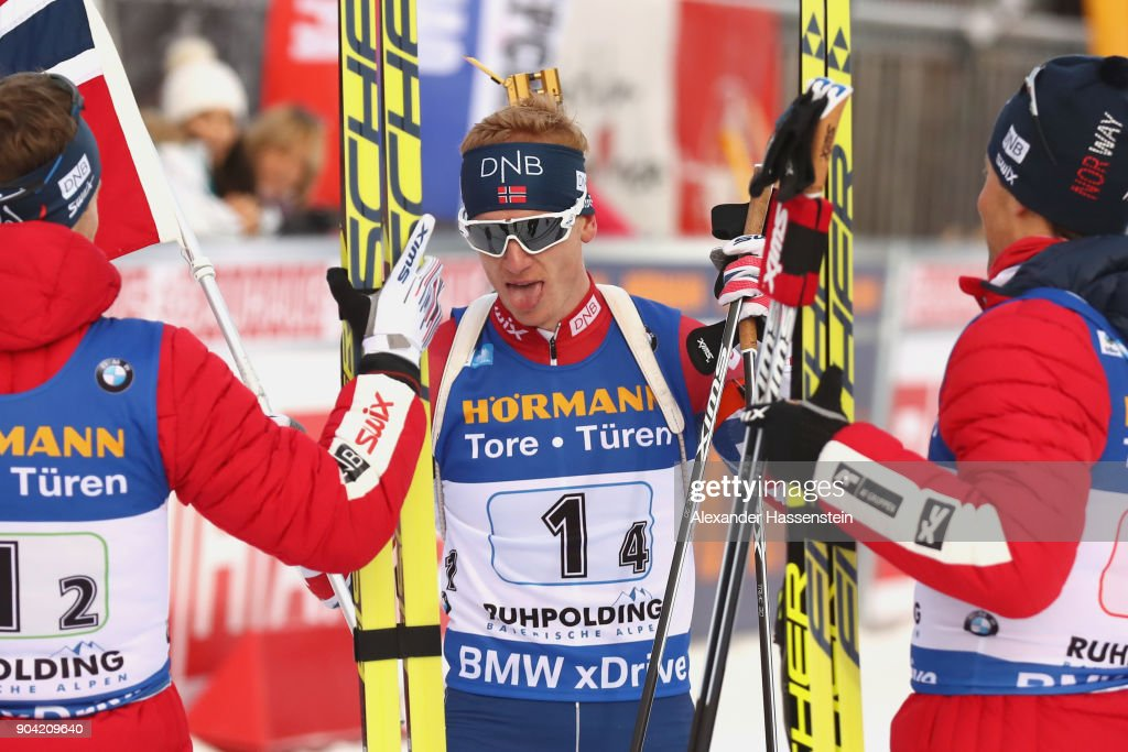 Johannes Thingnes Boe (C) of Norway celebrates victory with his team mates at the finish area after the men's 7,5km relay competition during the IBU Biathlon World Cup at Chiemgau Arena on January 12, 2018 in Ruhpolding, Germany.