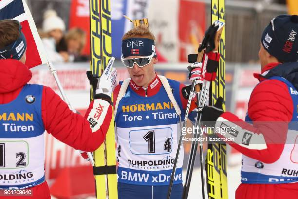 Johannes Thingnes Boe of Norway celebrates victory with his team mates at the finish area after the men's 75km relay competition during the IBU...