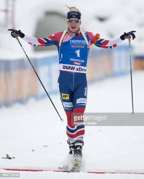 Johannes Thingnes Boe of Norway celebrates winning the 125 km Men's Pursuit during the BMW IBU World Cup Biathlon on December 9 2017 in Hochfilzen...