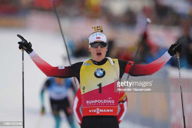 Johannes Thingnes Boe of Norway celebrates winning the Men 15 km Mass Start during the IBU Biathlon World Cup at Chiemgau Arena on January 18 2019 in...