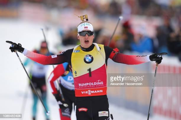 Johannes Thingnes Boe of Norway celebrates winning the Men 15 km Mass Start during the IBU Biathlon World Cup at Chiemgau Arena on January 20 2019 in...