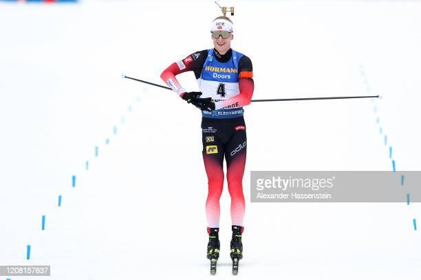 Johannes Thingnes Boe of Norway celebrates winning the Men 15 km Mass Start Competition at the IBU World Championships Biathlon AntholzAnterselva on...