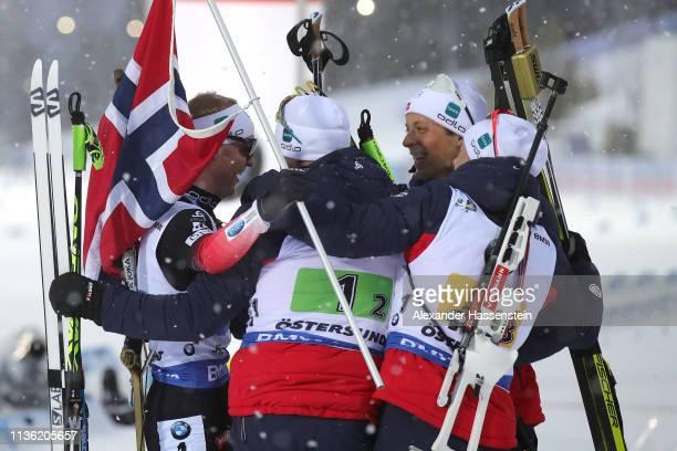 Johannes Thingnes Boe of Norway celebrates with his team mates at the finish area winning the IBU Biathlon World Championships Men's Relay at Swedish...
