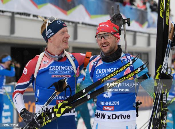 Johannes Thingnes Boe of Norway celebrates with Jakov Fak of Slovenia after winning the 125 km Men's Pursuit during the BMW IBU World Cup Biathlon on...
