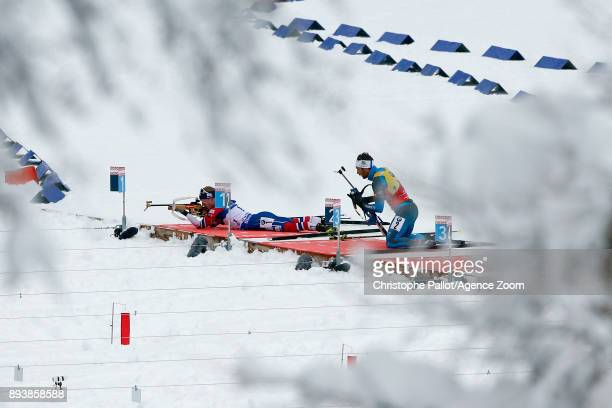 Johannes Thingnes Boe of Norway in action Martin Fourcade of France in action during the IBU Biathlon World Cup Men's and Women's Pursuit on December...