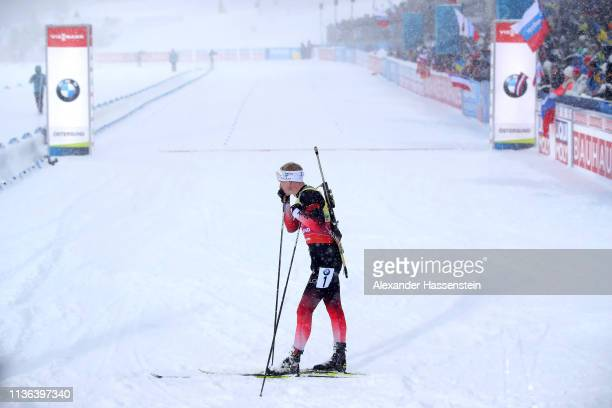 Johannes Thingnes Boe of Norway looks dejected in the finish area following the Men's Mass Start at the IBU Biathlon World Championships on March 17...