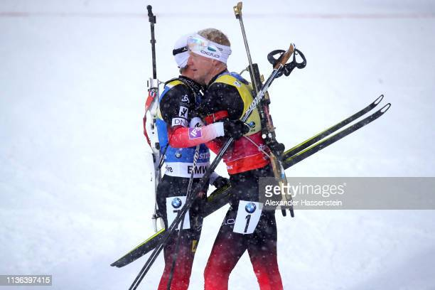 Johannes Thingnes Boe of Norway looks dejected with Tarjei Boe of Norway in the finish area following the Men's Mass Start at the IBU Biathlon World...