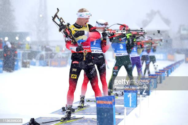 Johannes Thingnes Boe of Norway prepares to shoot at the shooting range in the Men's Mass Start at the IBU Biathlon World Championships on March 17...