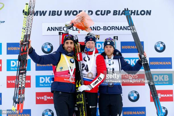 Johannes Thingnes Boe of Norway takes 1st place Martin Fourcade of France takes 2nd place Antonin Guigonnat of France takes 3rd place during the IBU...