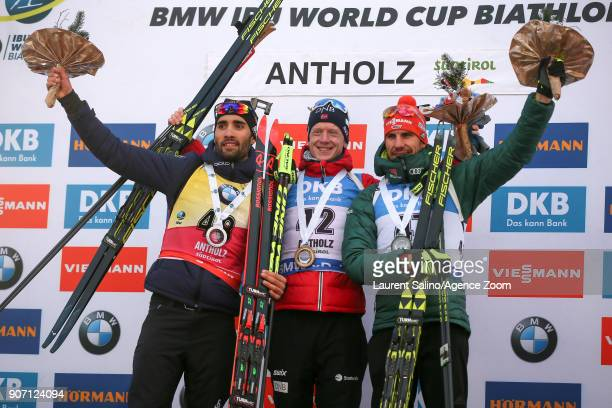Johannes Thingnes Boe of Norway takes 1st place Martin Fourcade of France takes 2nd place Arnd Peiffer of Germany takes 3rd place during the IBU...