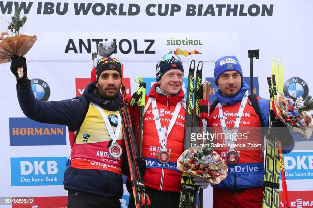 Johannes Thingnes Boe of Norway takes 1st place Martin Fourcade of France takes 2nd place Anton Shipulin of Russia takes 3rd place during the IBU...