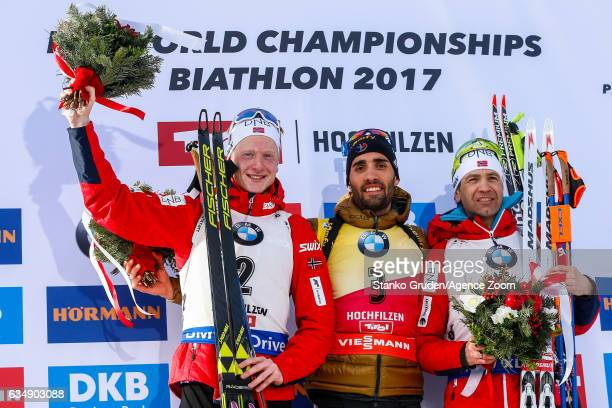Johannes Thingnes Boe of Norway wins the silver medal Martin Fourcade of France wins the gold medal Ole Einar Bjoerndalen of Norway wins the bronze...