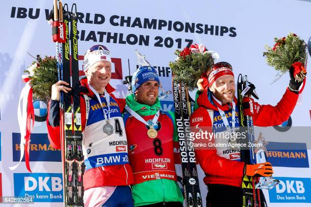Johannes Thingnes Boe of Norway wins the silver medal Simon Schempp of Germany wins the gold medal Simon Eder of Austria wins the bronze medal during...