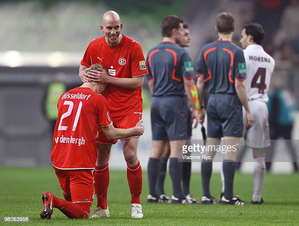 Johannes van den Bergh knies in front of his team mate Stephan Sieger of Fortuna to celebrate winning the Second Bundesliga match between Fortuna...