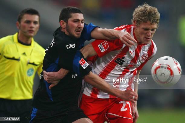 Johannes van den Bergh of Duesseldorf is challenged by Sascha Moelders of Frankfurt during the Second Bundesliga match between Fortuna Duesseldorf...