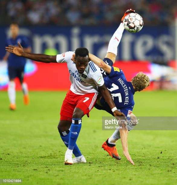 Johannes van den Bergh of Holstein Kiel is challenged by Khaled Narey of Hamburger SV during the Second Bundesliga match between Hamburger SV and...