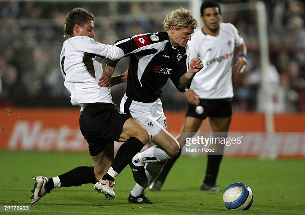 Johannes van den Bergh of Moenchengladbach II is attacked by Marvin Braun of St.Pauli during the Third League match between FC St.Pauli and Borussia...