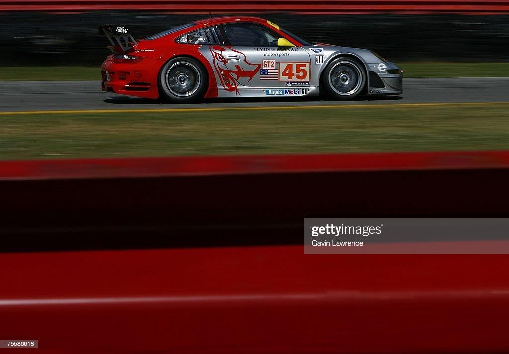 Johannes Van Overbeck And Jorg Bergmesiter Driving The #45 Flying Lizard  Motorsports Porsche 911 GT3 Good Ideas