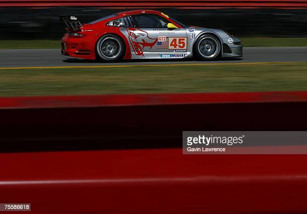 Johannes Van Overbeck and Jorg Bergmesiter driving the Flying Lizard Motorsports Porsche 911 GT3 RSR during the American Le Mans Series Acura Sports...