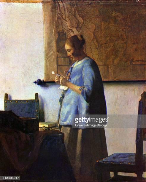 Johannes Vermeer Dutch artist 'Woman reading a letter' or 'Woman in Blue Reading a Letter' ca 16621663