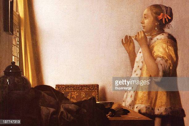 Johannes Vermeer's A young girls tries on a Pearl necklace 1655
