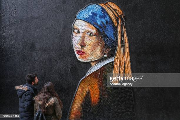 Johannes Vermeer's ''Girl With A Pearl Earring'' made from plastic cover by municipal personnel as part of the ''recycling street'' project in...
