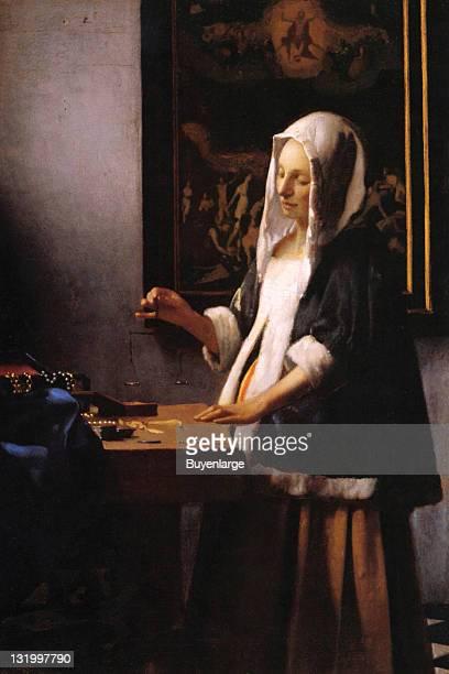 Johannes Vermeer's 'Woman Holding A Balance' 1665