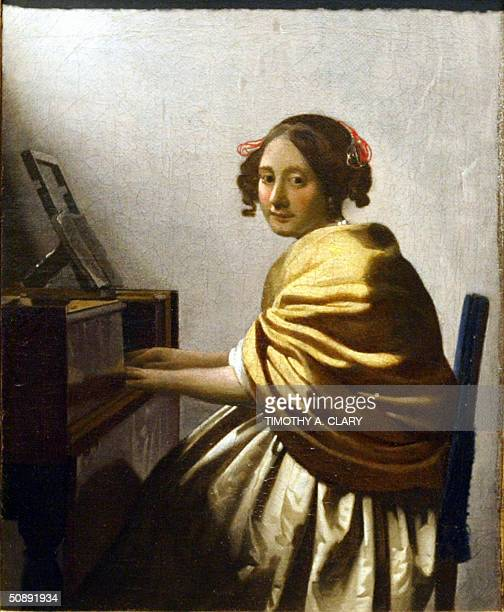 Johannes Vermeer's 'Young Woman Seated at the Virginals' c 1670 hangs on display at Sotheby's New York 24 May 2004 The painting is the Dutch artist's...