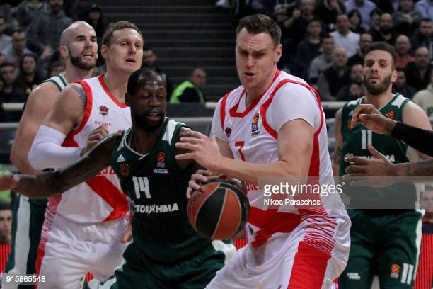 Johannes Voigtmann #7 of Baskonia Vitoria Gasteiz competes with James Gist #14 of Panathinaikos Superfoods Athens during the 2017/2018 Turkish...
