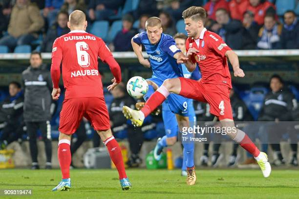 Johannes Wurtz of Bochum and Dustin Bomheuer of Duisburg battle for the ball during the second Bundesliga match between VfL Bochum 1848 and MSV...