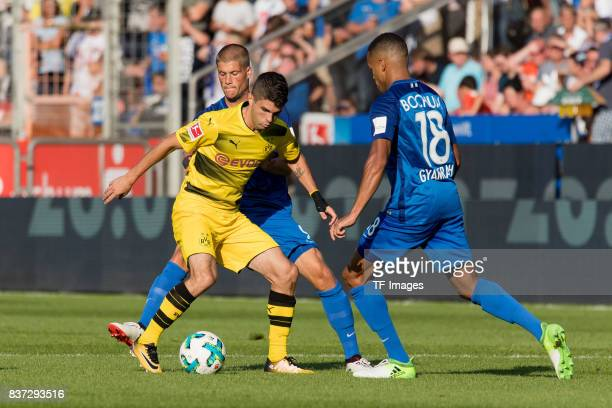 Johannes Wurtz of Bochum Christian Pulisic of Dortmund and Jan Gyamerah of Bochum battle for the ball during the preseason friendly match between VfL...