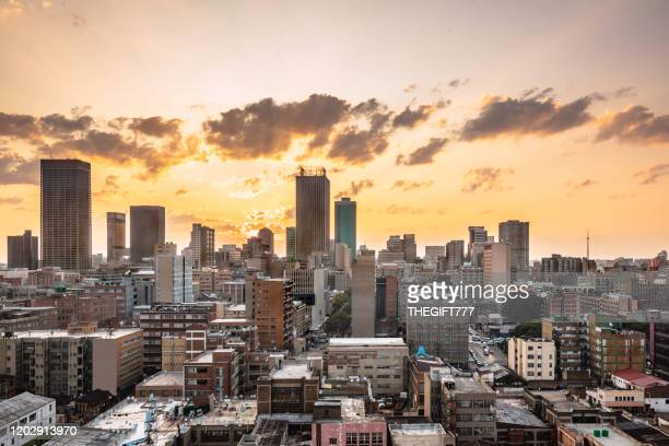 johannesburg city centre cityscape panorama at sunset - gauteng province stock pictures, royalty-free photos & images