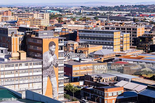 johannesburg city with a murial of nelson mandela the boxer. - johannesburg stock pictures, royalty-free photos & images