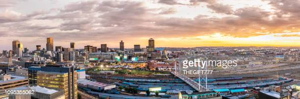 johannesburg cityscape with nelson mandela bridge panorama - gauteng province stock pictures, royalty-free photos & images