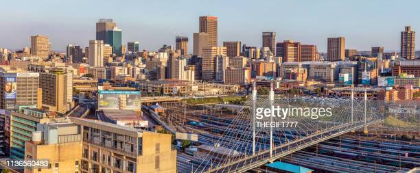 johannesburg cityscape with nelson mandela bridge - gauteng province stock pictures, royalty-free photos & images