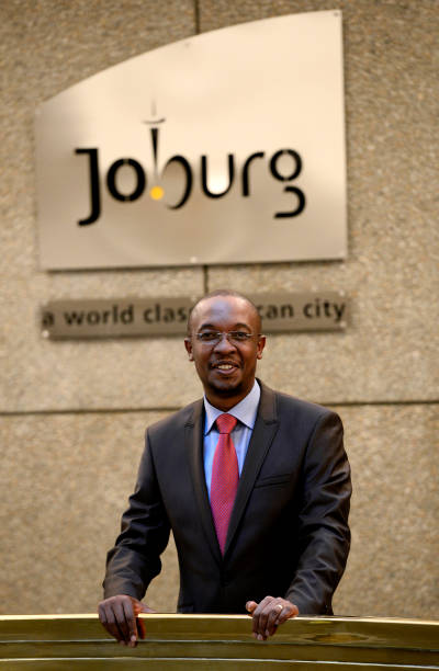 Johannesburg mayor parks tau poses on may 22 2013 in his office in johannesburg mayor parks tau poses on may 22 2013 in his office in south africas altavistaventures Choice Image