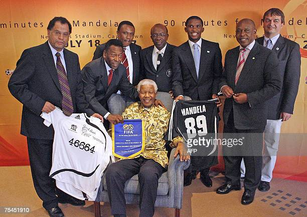 Former South Africa President Nelson Mandela is awarded a playing jersey by SA 2010 LOC CEO Danny Jordaan Brazilian football legend Pele SA 2010 LOC...