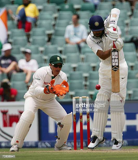 India's batsman Zaheer Khan plays a shot bowled by Graeme Smith as wicket keeper Mark Boucher waits to make a catch 17 December 2006 on the 3rd day...