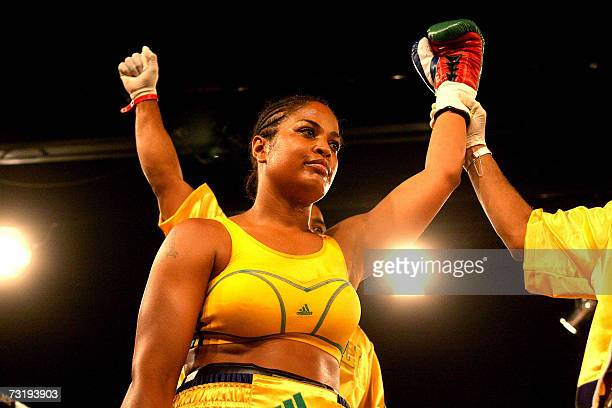 Laila Ali boxing champion and daughter of boxing legend Muhammad Ali lift the fist 03 February 2007 after knocking Guyanan boxer Gwendolyn O' Neill...