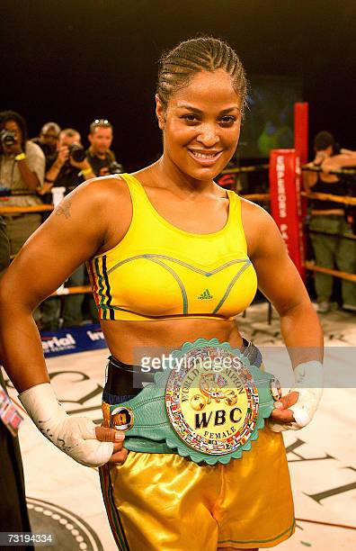 Laila Ali boxing champion and daughter of boxing legend Muhammad Ali poses for pictures after winning against 03 February 2007 Guyanan boxer...
