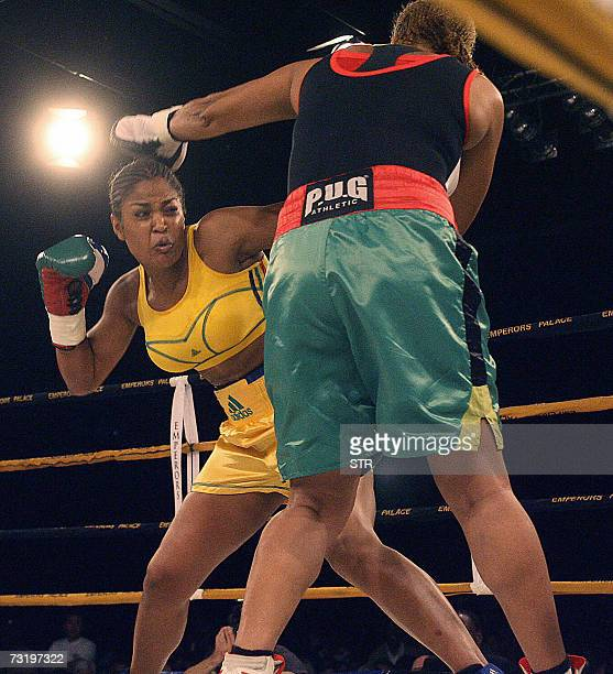 QUALITY REPEAT Laila Ali boxing champion and daughter of boxing legend Muhammad Ali' hits 03 February 2007 Guyanan boxer Gwendolyn O' Neil during the...