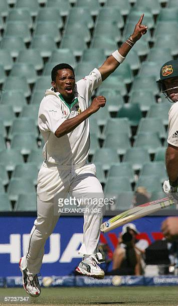 South Africa's bowler Makhaya Ntini celebrates taking out Australian opening batsman Matthew Hayden for a duck on the fourth day of the third fiveday...