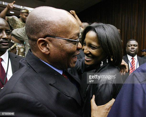South Africa's former deputy president Jacob Zuma embraces his daughter Duduzile Zuma after being acquitted of rape in Johannesburg 08 May 2006 Zuma...