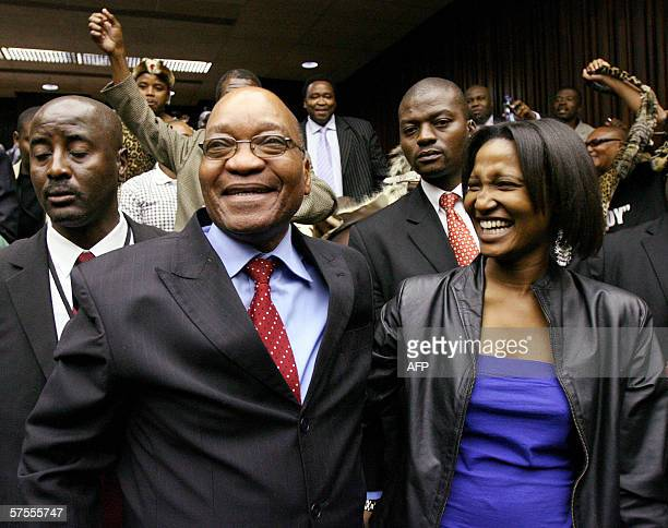 South Africa's former deputy president Jacob Zuma embraces his daughter Duduzile Zuma after being acquitted of rape at Johannesburg High Court in...